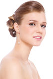 Prom make-up and hairdo. Young beautiful blond girl with prom make-up and hairdo, over white background stock photo