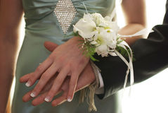 Prom Night. Hands of a young couple headed to prom Royalty Free Stock Photo