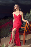 Prom night. An attractive girl dressed in red for her prom party royalty free stock photos