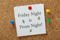 Prom Night Reminder. Friday Night is Prom Night reminder note pinned to a cork notice board Stock Photography