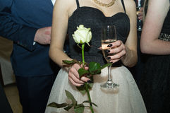 At the prom party. Boleslawiec, Poland, February 11 2017, a girl with a rose and a glass of champaigne during the prom party in a high school in Boleslawiec Stock Images