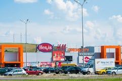 Promenada mall entrance, colorful logos on the building. Targu Mures, Romania-01 June 2018: Promenada mall entrance, colorful logos on the building stock photo