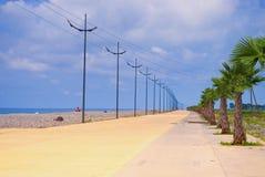 Promenade along beach Stock Images