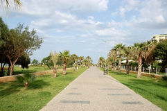 Promenade along the beach in the Turkish resort of Side. Royalty Free Stock Image