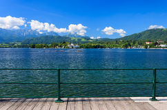 Promenade along beautiful lake on sunny summer day Stock Photography