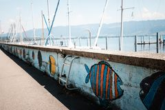 Promenade along Lake Constance painted with colorful fish. Bodensee stock images