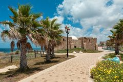 Promenade along Mediterranean sea and ancient tomb of unknown sh stock images