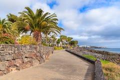 Promenade along ocean in Playa Blanca town Stock Images