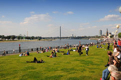 Promenade along the Rhine. Picnic on the banks of the Rhine in Dusseldorf Royalty Free Stock Image