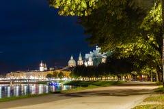 Promenade along the Salzach river at night. Salzburg. Austria Stock Images