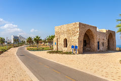 Promenade and ancient tomb in Ashqelon, Israel. Bicycle path on promenade along Mediterranean sea coast with palms and ancient tomb of unknown shah in Ashkelon Stock Image