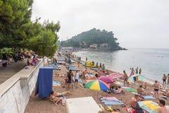 Promenade and beach of Petrovac in Montenegro stock photo
