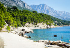 Promenade of Brela at Makarska Rivier, Biokova mountains in the back Royalty Free Stock Photography