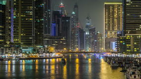 Promenade and canal in Dubai Marina timelapse at night, UAE. stock video footage