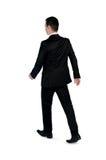 Promenade d'homme d'affaires loin Image stock