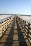 Promenade in das Meer Stockbild