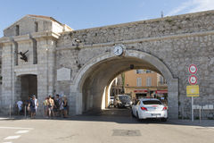 Promenade de l'Amiral de Grasse, Antibes, France. Promenade de l'Amiral de Grasse street in Antibes with the entrance in the old town. Antibes is a Mediterranean Royalty Free Stock Image