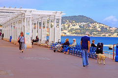 Promenade des Anglais in Nice, France. NICE, FRANCE - MAY 14: the Promenade des Anglais on May 14, 2013 in Nice, France. Nice is a popular Mediterranean tourist stock photography