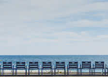 Promenade des Anglais seaside in Nice with blue chairs Royalty Free Stock Photos