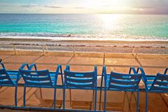 Promenade des Anglais waterfront of Nice benches looking at Mediterranean sunset. Famous coastline of French riviera, Alpes Maris region of France royalty free stock photography