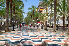 The promenade Explanada of Spain in Alicante. ALICANTE, SPAIN - July 6, 2015:  The promenade Explanada of Spain in Alicante, lined by palm trees, is paved with 6 Royalty Free Stock Images