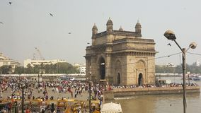 Promenade of Gateway of India, Mumbai. The Gateway of India is an arch monument built during the 20th century in Bombay, India. The monument was erected to Stock Photography