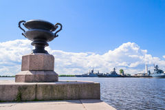 Promenade in Kronstadt, St. Petersburg. Kronstadt, scenic views. The sculpture is a bowl of granite. Military Russian ships royalty free stock photo