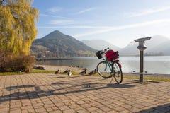 Promenade lake schliersee in autumn, trekking bike and spy glass Royalty Free Stock Photo