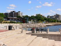 Promenade on the lakeshore. A view on the edge of the lake Ontario with the beautiful promenade and Royalty Free Stock Photography