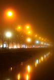 Promenade lights in the fog. Difraction lights Stock Image