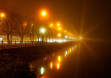 Promenade lights in the fog. Difraction lights Royalty Free Stock Photos