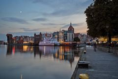 Promenade and Main Town in Gdansk at dusk. View of boats and old buildings on the Long Bridge waterfront at the Main Town Old Town and promenade in Gdansk Royalty Free Stock Image