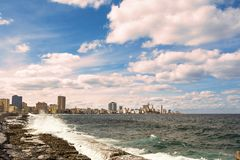 Promenade of the Malecon of Havana with crashing waves. The Promenade of the Malecon of Havana with crashing waves Stock Images