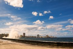 Promenade of the Malecon of Havana with crashing waves. The Promenade of the Malecon of Havana with crashing waves Stock Photography