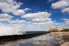 Promenade of the Malecon of Havana, Morro Castle and its lightho. Use with crashing waves Royalty Free Stock Photography