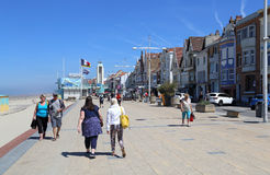 Promenade of Malo les Bains beach in Dunkirk, France. Dunkirk, France - May 31, 2017: Tourists walk on the promenade at the Malo les Bains beach resort of Royalty Free Stock Photo