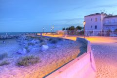 Promenade near the sea, Saintes-Maries-de-la-mer, France, HDR Royalty Free Stock Photography
