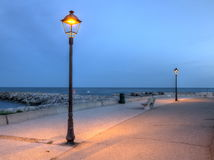 Promenade near the sea, Saintes-Maries-de-la-mer, France, HDR royalty free stock photos