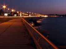 Promenade at night. Seaside promenade at night in street lamps lighting royalty free stock photos