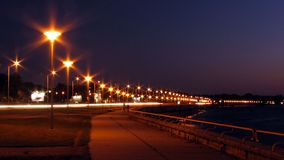Promenade at night. Seaside promenade at night in street lamps lighting stock photos