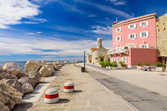 Promenade with old houses in a Sunny summer day, Piran, Slovenia. Royalty Free Stock Photos