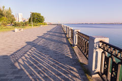 Promenade with paving stone and wrought iron railing in  Dniprop Royalty Free Stock Photography