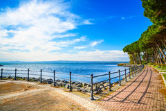 Promenade and pine trees in Bolsena lake, Italy. Stock Photos