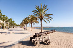 Promenade in Roses, Spain. ROSES, SPAIN - MAY 27: Old cannon on the waterfront promenade in Roses. May 27, 2015 in Catalonia, Spain Stock Image