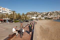 Promenade in Roses, Spain. ROSES, SPAIN - MAY 27: People on the waterfront promenade in mediterranean town Roses. May 27, 2015 in Catalonia, Spain Royalty Free Stock Images