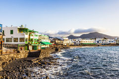Promenade of scenic Playa Blanca with seaside in the morning Stock Images
