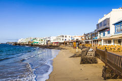 Promenade of scenic Playa Blanca with seaside in the morning Stock Photos