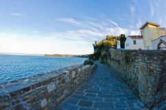 Promenade by the sea near city of Piran in Istria Royalty Free Stock Images