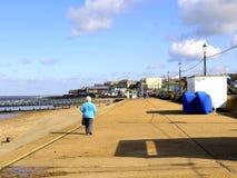 Promenade in September, Hunstanton. A senior pensioner walking the promenade in September at Hunstanton, Norfolk, East Anglia, England, UK Royalty Free Stock Images