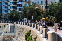 Promenade in Sliema, Malta on a beautiful sunny day. Promenade and people in Sliema, Malta in the summertime in 2018 Royalty Free Stock Image